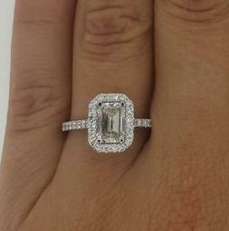 1.7 Ct Cathedral Halo Emerald Cut Diamond Engagement Ring SI