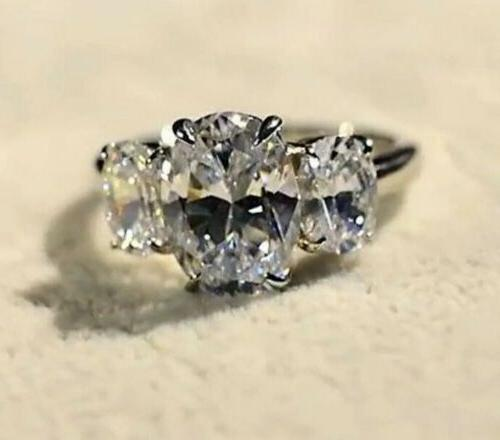 Moissanite oval rolled White ring