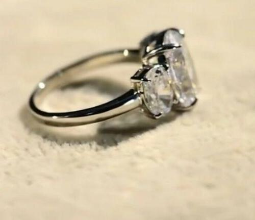 Moissanite Three oval rolled ring